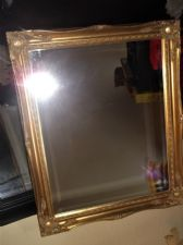 "GOOD SIZE BEVEL EDGE MIRROR WITH ORNATE GILT WOODEN FRAME 23.5"" X 19.25"""